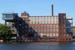 DAILY BREAD office building Berlin - monumental factory at Spree River