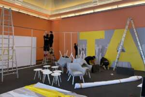 Set carpenters build background panel of mobile livestream studio